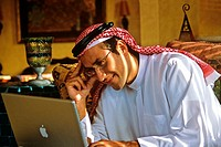 Arab man using a laptop