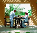 Arab men playing backgammon