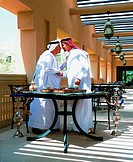Arab men rubbing their noses traditional greeting