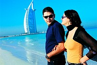 Western couple on the beach near Burj Al Arab hotel in Dubai, UAE (thumbnail)