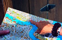 Tourist looking at a map of Dubai, UAE