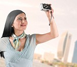 Arab woman taking pictures of Dubai landmarks