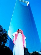 Saudi businessman outside Al Mamlakah Kingdom Tower in Riyadh, Saudi Arabia (thumbnail)