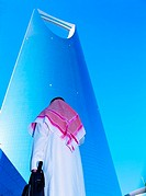 Saudi Businessman outside Al Mamlakah Kingdom Tower in Riyadh, Saudi Arabia