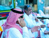 Saudi man using mobile phone in Old Town of Jeddah, Saudi Arabia