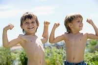 Boys flexing muscles