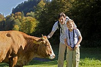Father, son, hiking, cow, caresses, laughs,