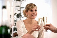 Young woman clinking champagne glass