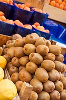 Kiwi fruits, lemons and apricots at a market