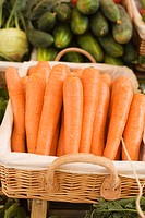 Carrots in a basket at a market (thumbnail)