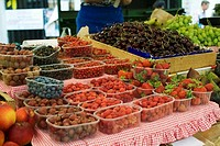 Fresh berries, cherries and grapes at a market (thumbnail)