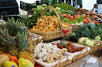 Market stall with fruit, vegetables, mushrooms and herbs