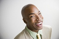 Close up of African businessman laughing