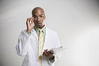 African male doctor with chart