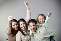 Studio shot of Hispanic family cheering