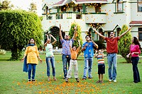 Group of people tossing flowers