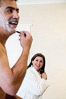 Middle-aged couple getting ready in morning