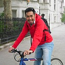 Asian man on bicycle in urban area