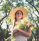 Hispanic woman holding bouquet of wildflowers