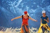 Two women in mountains, hiking