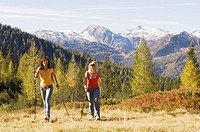 Two women in mountains, nordic walking