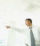 Asian businessman pointing