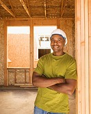 Male construction worker smiling inside construction site