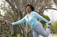 Senior African woman stretching in park