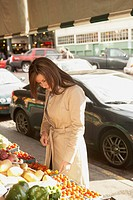 Hispanic woman at sidewalk market