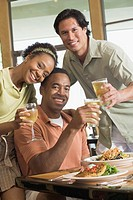 Multi-ethnic friends drinking at restaurant