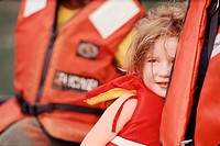Young girl and parent wearing life-jackets