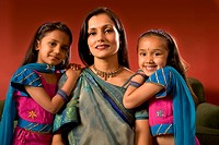 Indian mother and daughters in traditional dress