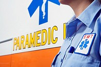 Close up of paramedic next to ambulance