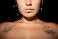 Portrait of woman with piercings and tattoos