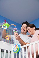 Couple Hanging Mobile on Baby Bed