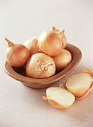 Several onions in a bowl