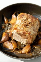 Roast loin of pork with garlic and sage