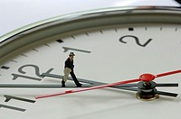Clock with figurine on pointer, close-up