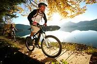 Germany, Bavaria, Couple mountain biking