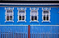 Four windows on a blue russian house. Near Ufa. Bashkortostan. Russia