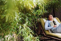 Mature woman sleeping on a lounge chair