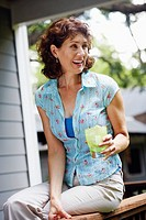 Mature woman holding a glass of lemonade