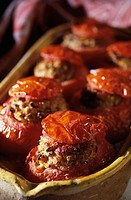 Stuffed tomatoes in a baking dish