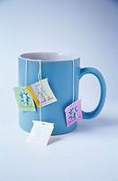 Several tea bags in a mug