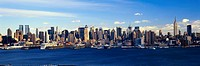 Panoramic view of Empire State Building and Manhattan, NY skyline with Hudson River and harbor