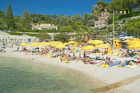 Sunbathers on beach on French Riviera, France