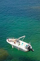 Sunbathers on boat on Mediteranean near Villefranche sur Mer, French Riviera, France