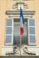 French flag flying from window