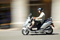 Man riding moped