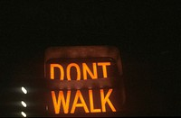 "A sign that reads ""Don't Walk"""